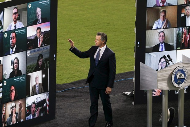 Gov. Newsom waves to virtual guests during the State of the State address at Dodger Stadium on March 9, 2021. - PHOTO BY SHAE HAMMOND FOR CALMATTERS