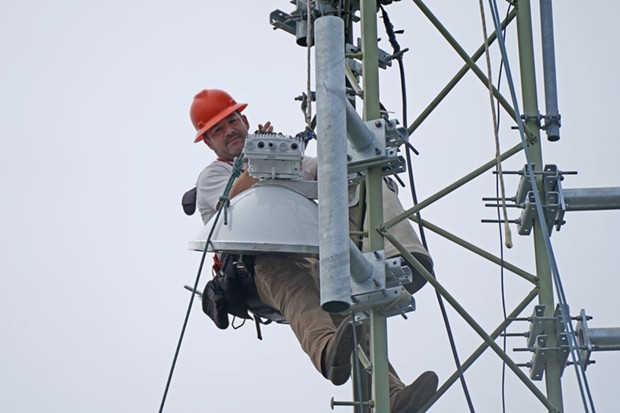 Yurok Connect Coordinator Duston Offins installs a new antenna on a tower in Requa during the implementation of the Yurok Connect Broadband Project. - YUROK TRIBE