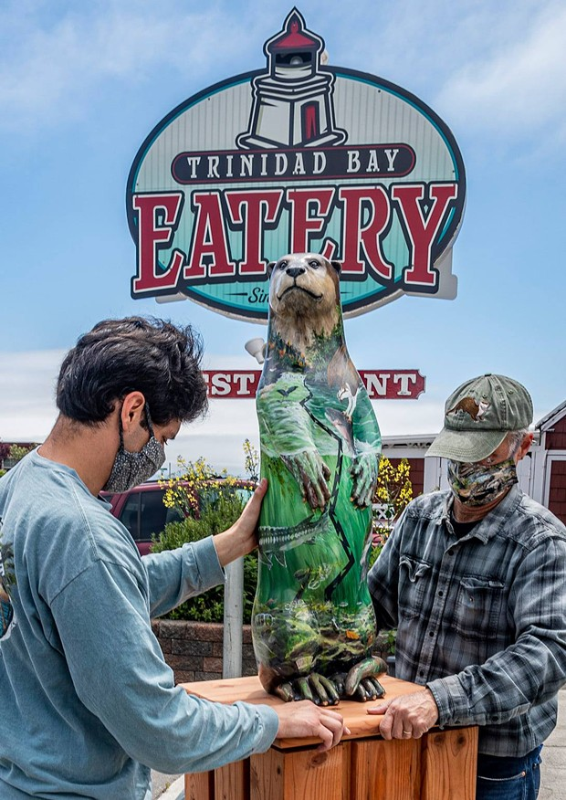 Amanita Mollier's otter is prepped for installation at the Trinidad Bay Eatery and Gallery by Ben Sparks and professor Jeff Black. - MARK LARSON