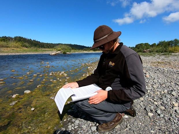 The Blue Lake Rancheria Tribe's Environmental Scientist Jacob Pounds samples the algae mats for analysis. - BLUE LAKE RANCHERIA