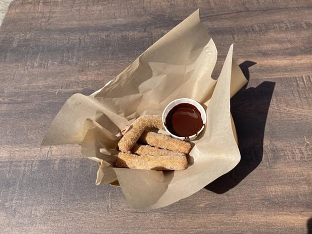 Pâte à choux churros with warm chocolate ganache. - PHOTO BY JENNIFER FUMIKO CAHILL