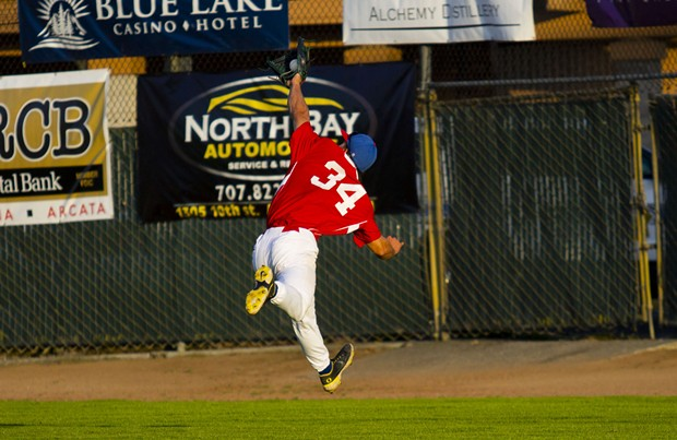 Crabs outfielder Tyler Ganus (#34) makes a leaping play to catch a long fly ball in right field on June 19, 2021 against the Seattle Studs at Arcata Ballpark. - THOMAS LAL