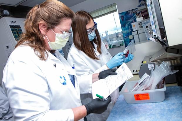 Humboldt County Public Health Laboratory staff Paula Moon (left) and Alyssa McCloud catalog incoming tests. - PUBLIC HEALTH