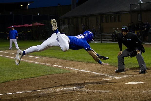 Crabs third baseman David Morgan (No. 20) attempts to leap into home while playing against the Petaluma Leghorns on July 7, 2021 at Arcata Ballpark. - THOMAS LAL