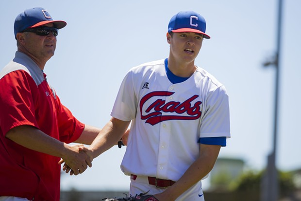 Crabs manager Robin Guiver shakes pitcher Owen Stevenson's hand after Stevenson's last inning of work on July 18, 2021 against the West Coast Kings. - THOMAS LAL