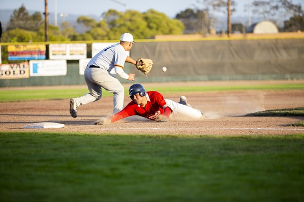 Crabs second baseman Ethan Fischel slides into third past the throw for a triple on July 23 while facing TKB Baseball at Arcata Ballpark. - THOMAS LAL