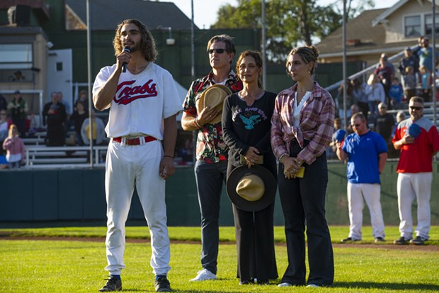 Crabs outfielder Tyler Ganus sings the national anthem with his family on the field with him ahead of the Crabs' game against the Prescott Roadrunners on July 28, 2021. - THOMAS LAL