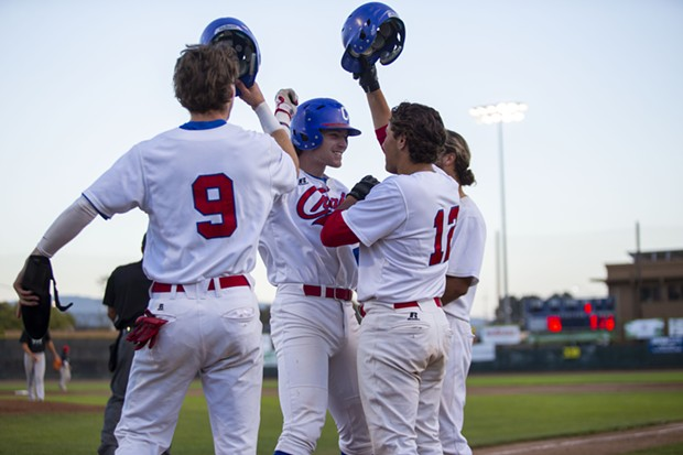 Crabs outfielder Josh Lauck celebrates with teammates at home plate after hitting a grand slam against the Prescott Roadrunners on July 28, 2021. - THOMAS LAL