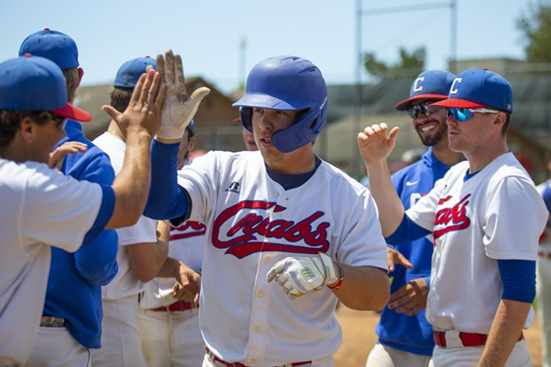 Crabs outfielder Aidan Morris is congratulated by teammates after hitting the team's 41st home run of the season, breaking the single season wood bat record for the team as a whole on August 1, 2021 at Arcata Ballpark. - THOMAS LAL