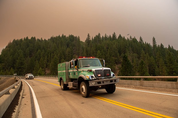 Forest service vehicles head toward the town of Wildwood on State Route 36. - MARK MCKENNA