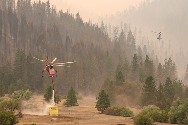 A Sikorsky helicopter refills its tank at a dip point whole working the McFarland Fire. - MARK MCKENNA
