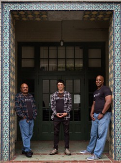 Mark Taylor, left, Tony Wallin and Eric Clark, far right, at the Humboldt State University campus - PHOTO BY DAVE WOODY