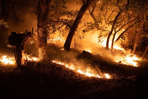 Firefighters from multiple agencies, including some that were pulled off the Monument Fire defended houses at the end of Enchanted Creek Lane last week. - MARK MCKENNA
