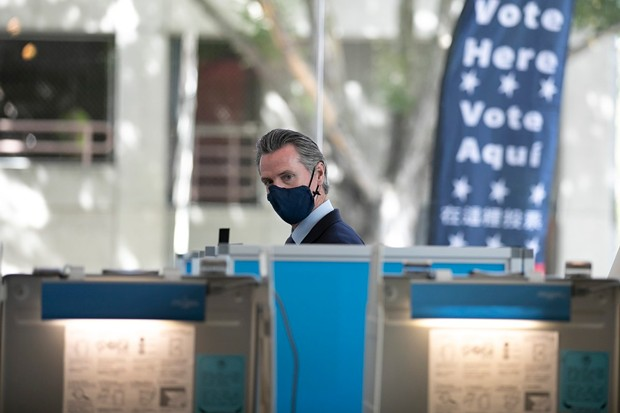 Gov. Gavin Newsom prepares to vote in the recall election at the Secretary of State building in Sacramento on Sept. 10, 2021. - PHOTO BY ANNE WERNIKOFF, CALMATTERS