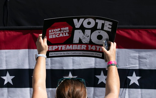 A Gavin Newsom supporter holds up a sign against the recall election at a campaign event at the IBEW-NECA training center in San Leandro on Sept. 8, 2021. - PHOTO BY ANNE WERNIKOFF, CALMATTERS
