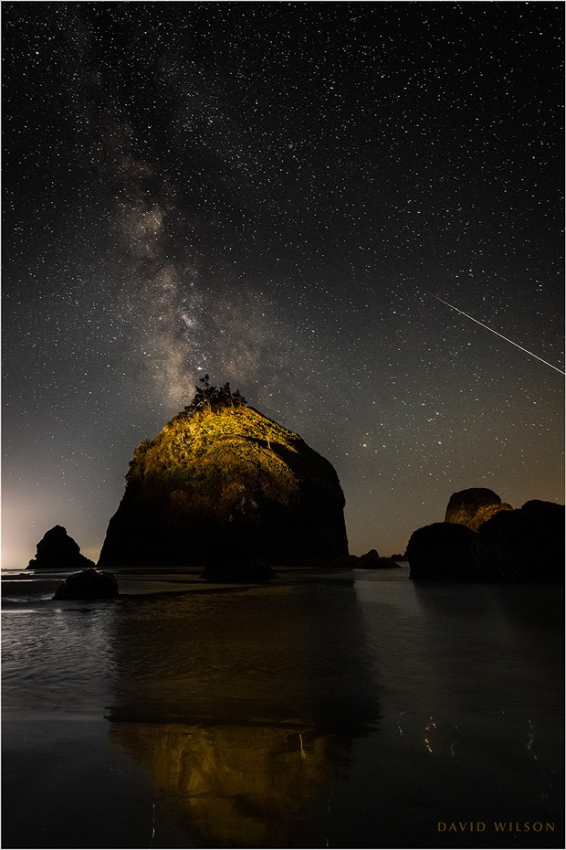 The one that got away. A large meteor streaks off the edge of the frame off the coast of Houda Beach. I had it by the tail…! The truth of the matter is that this is cropped in from the left edge; for some reason I had the great rock centered. If I had composed it the way I knew I should have at the time, the entire meteor would have been in. This is why my hair is gray. September 10, 2021, in Humboldt County, California. - DAVID WILSON