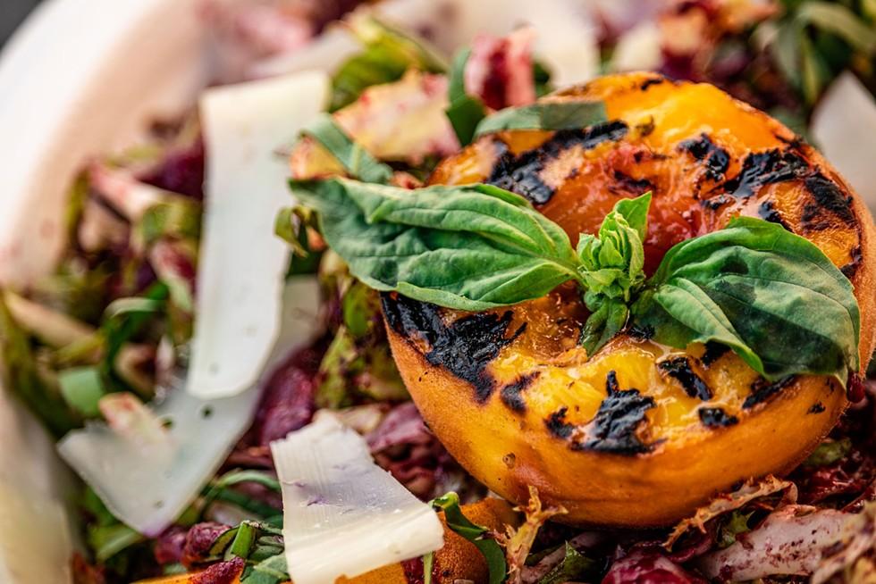 Market salad with seared peach. - RYAN MCGAUGHEY
