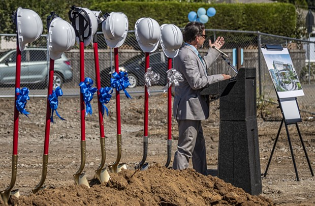 Tory Starr (left), president of the Open Door Community Health Centers, welcomed attendees to the ground-breaking event on the future site of the Arcata Community Health Center located between Foster and Sunset avenues. - MARK LARSON