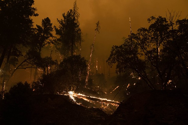 The lightning-caused Monument Fire jumped State Route 299 in several places near Del Loma. Started July 30, it is now 61 percent contained. - MARK MCKENNA