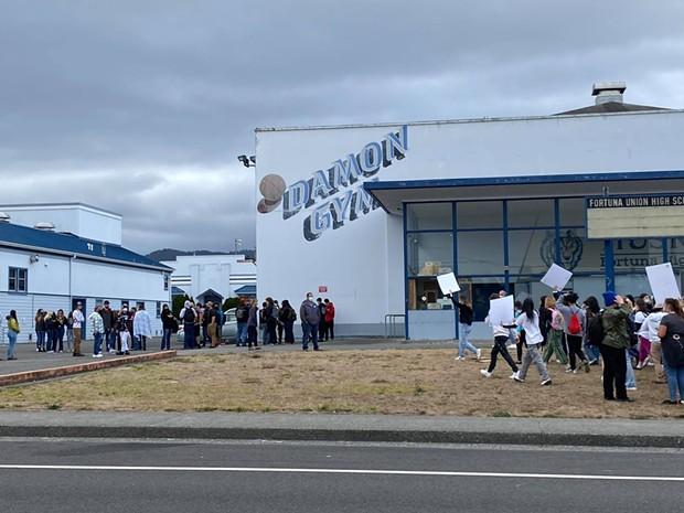Students walk out at Fortuna High School. - MARK MCKENNA