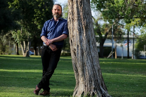 David Walter stands for a portrait at Encino Park in Encino on March 23, 2021. David is an adjunct professor at UC Berkeley lecturing on humanities and creative writing. - PHOTO BY SHAE HAMMOND FOR CALMATTERS