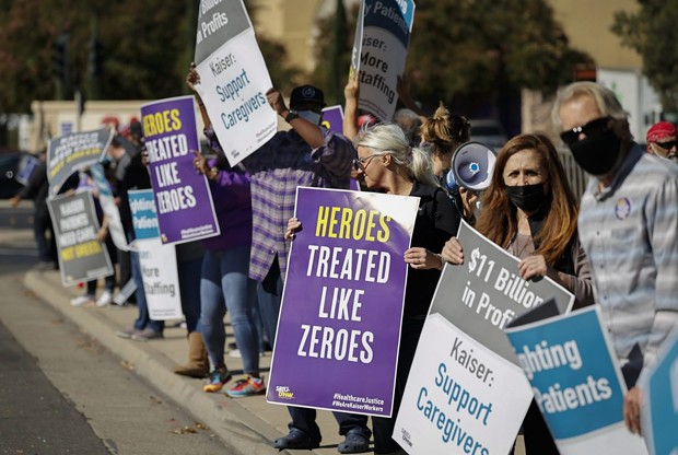 Hospital staffers and union organizers waved signs and banners in protest over staffing shortages at Kaiser Permanente Hospital in Roseville on Oct. 14, 2021. - PHOTO BY FRED GREAVES FOR CALMATTERS