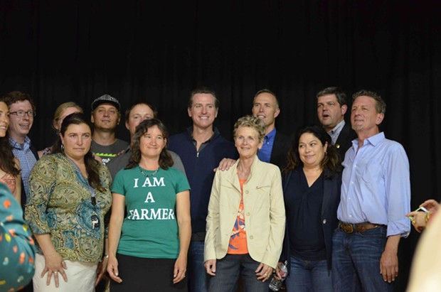 Gavin Newsom (center) poses with Second District Supervisor Estelle Fennell, Congressman Jared Huffman, Assemblyman Jim Wood, Trinity County Supervisor Judy Morris and members of California Cannabis Voice. - GRANT SCOTT-GOFORTH