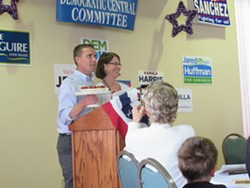 """Sen. Mike McGuire displays District Attorney Maggie Fleming's """"Criminally Delicious"""" Cheesecake. - LINDA STANSBERRY"""