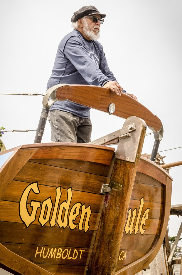 Michael Gonzalez, of Trinidad, pauses for a moment on the rear deck of the Golden Rule prior to its launching on Saturday, June 20 at the Zerlang & Zerlang  boat yard on the Samoa peninsula. He said he was easily persuaded to join the restoration project over three years ago when he heard it was a wooden boat. - MARK LARSON