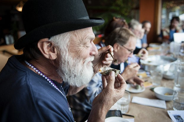 James Smith savors a contender during the Best Raw Oyster, Best Cooked Oyster and Best Non-oyster  judging. - MARK MCKENNA