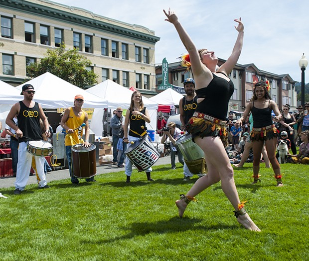 Drummers and dancers from Olio Music and Dance Collective entertain the crowd. - MARK MCKENNA