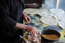 Pizza prep at Folie Douce - DREW HYLAND