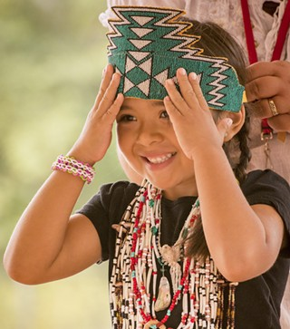 Dakotarose Scott, 5, of Klamath, adjusts her crown. - MARK LARSON