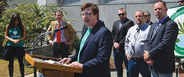 CCVH treasurer Luke Bruner announces the draft ordinance in July. - GRANT SCOTT-GOFORTH