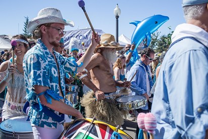 Drums and dancers beat a rhythm and a path around the Arcata Plaza on the first day of the festival. - ALEXANDER WOODARD