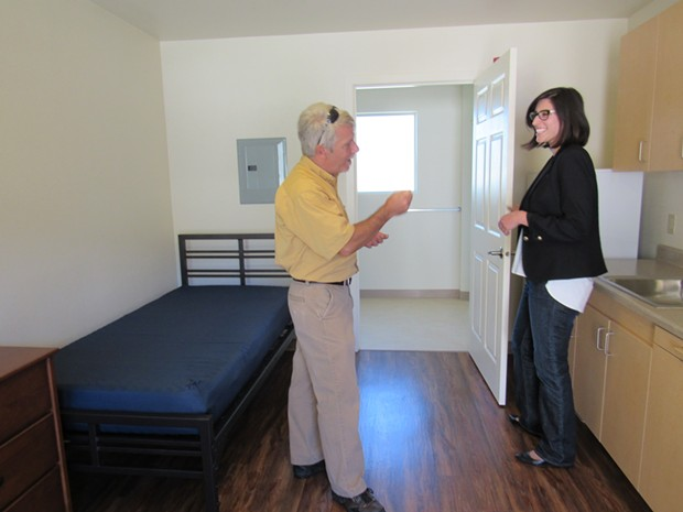 County Supervisor Mark Lovelace and Arcata City Councilmember Sofia Pereira check out the interior of one of the new apartments. - LINDA STANSBERRY