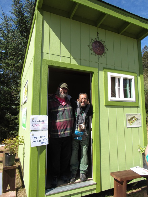 Carlos Hererra, Paul Lucas and their dog, Maybe, check out a tiny home. - LINDA STANSBERRY