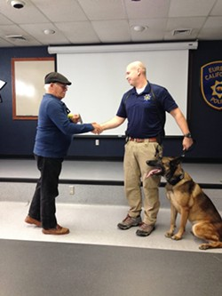 A local homeowner presents EPD Officer Leonard LaFrance and K-9 Vex with a token of his appreciation. - SUBMITTED