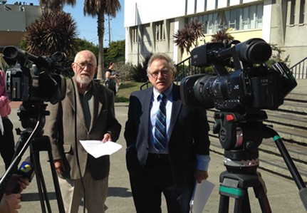 Leo Sears (left) stands with his attorney, Bill Bertain, while announcing the filing of his conflict of interest lawsuit against the Humboldt County Harbor, Conservation and Recreation District this afternoon. - THADEUS GREENSON