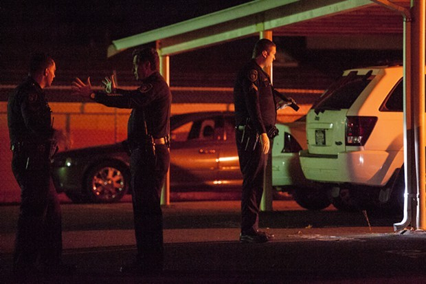 Police Chief Andy Mills (center) talks with officers at the scene of the fatal Oct. 21 shooting. - MARK MCKENNA