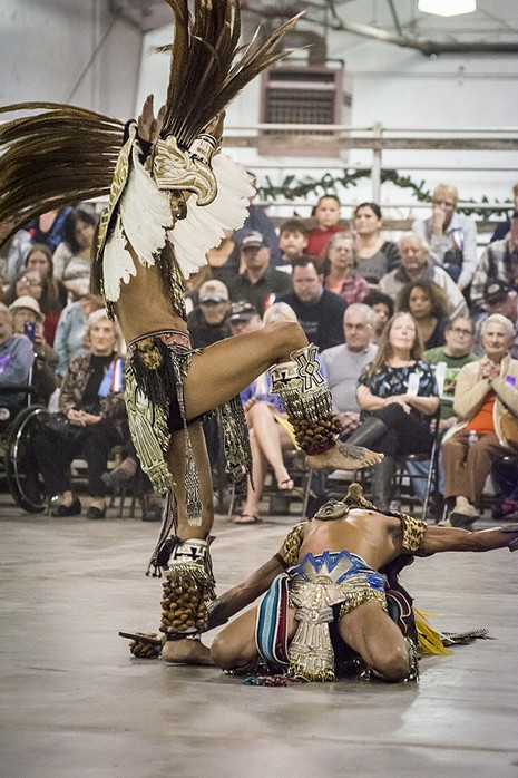 A packed house at Redwood Acres watched the eagle and jaguar dance by Aztec Dance and Drum group. - MARK LARSON
