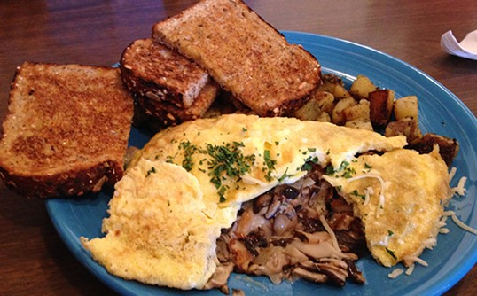 The mushroom omelette reveals its bounty. - JENNIFER FUMIKO CAHILL