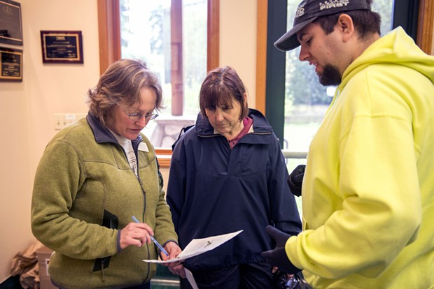Sequoia Park Zoo Manager Gretchen Ziegler, left, talks with volunteers Jeanne Wielgus, of McKinleyville,  and Wesley Frietas, of Eureka, about the location of bamboo they had found in the search area he was assigned Saturday Morning. - MARK MCKENNA