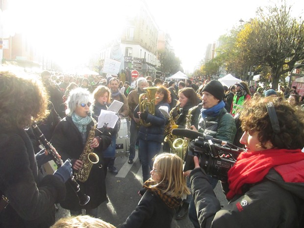 """A Parade, part of the """"alternative"""" conference in Montreiul, a suburb of Paris on Dec. 5. - DAVID SIMPSON"""