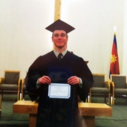 Jason Dale Johnson receiving his high school diploma last spring. - SUBMITTED