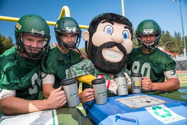 "Jacks football players and mascot ""Lucky"" pose with reusable cups. - HSU"