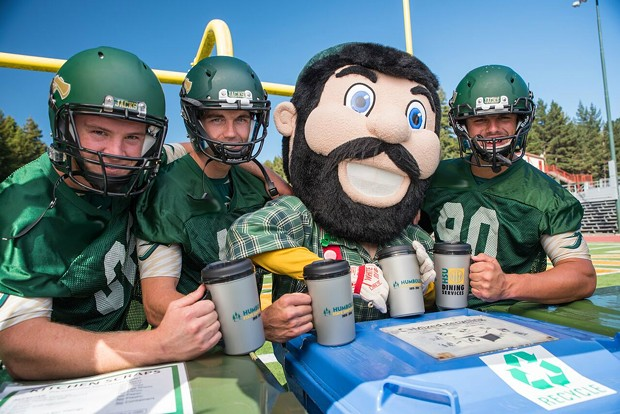 "Jacks football players and mascot ""Lucky"" pose with reusable cups. - HSU"
