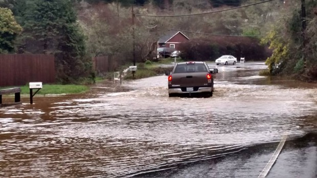 Weekend rains caused plenty of flooded roads, including Freshwater Road shown here. - FACEBOOK/MARK LOVELACE