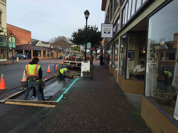 Construction crews measure out the parklet's dimensions. - GRANT SCOTT-GOFORTH