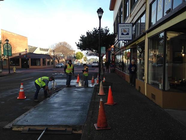 Smoothing out the concrete. - THADEUS GREENSON